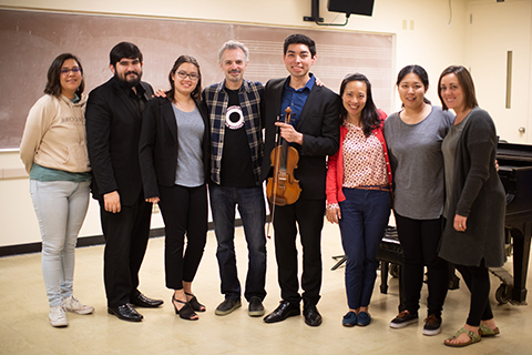 string musicians posing for photo