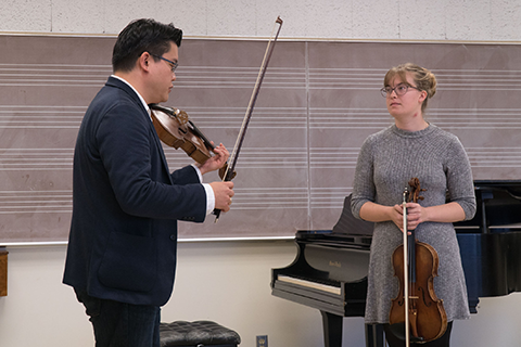 Viola instructor working with student