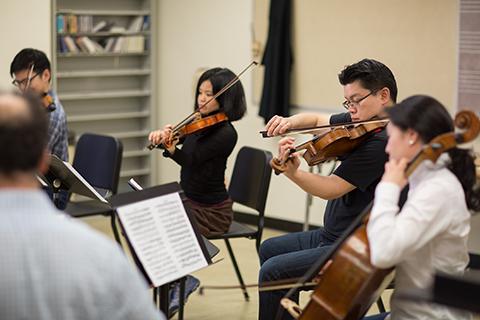 String quartet performing in classroom