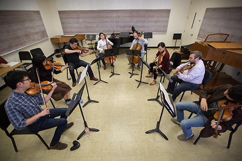 String musicians performing in class