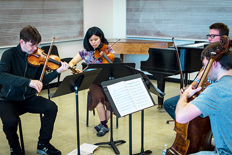 String quartet performing in classroom