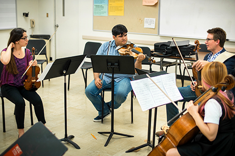 Violin instructor working with chamber group