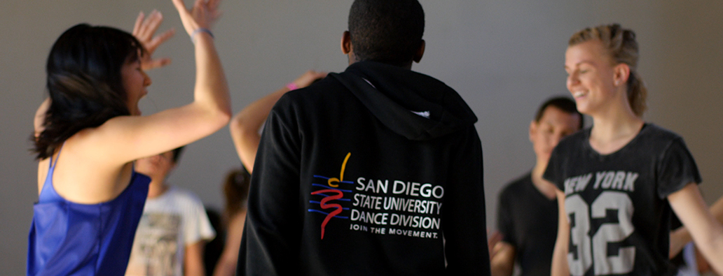 Dancer with hoodie that says SDSU Dance Division, Join the Movement